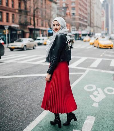 Leather Jacket and Red Pleated Skirt