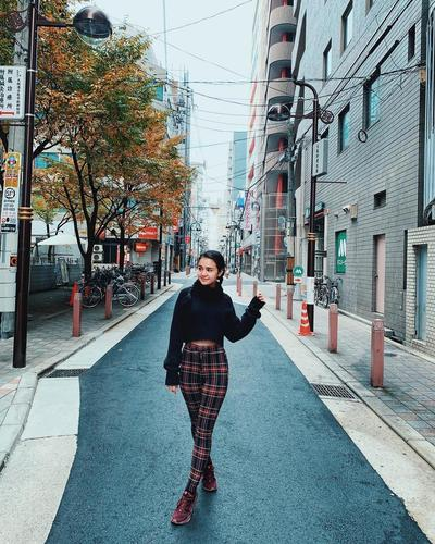 Black Sweater and Plaid Skirt
