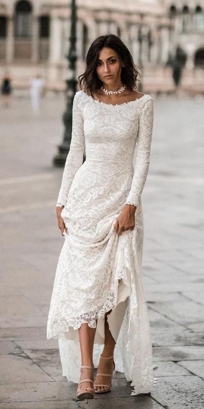 1.  Long Sleeve Lace Wedding Dress